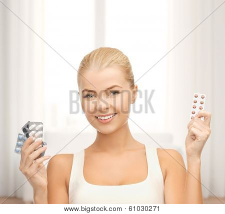 medicine, health, diet and pharmacy concept - young woman with variety of pills