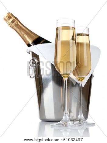 Glasses of champagne and bottle in pail, isolated on white