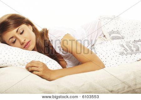 Portrait Of Beautiful Brunette Woman On Bed