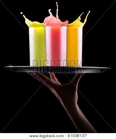 tasty summer fruit drinks with splash on tray