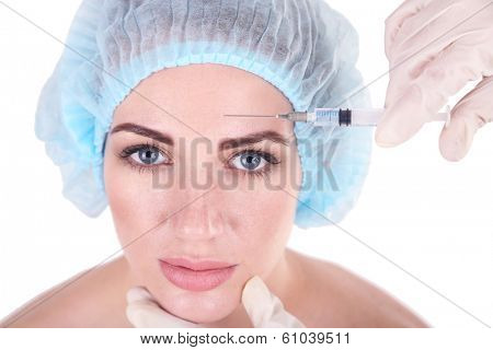 Woman in beauty clinic getting botox injection, isolated on white