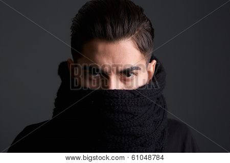 Intimidating Young Man With Scarf Covering Face