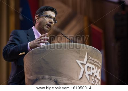 NATIONAL HARBOR, MD - MARCH 7, 2014: Author Dinesh D'Souza speaks at the Conservative Political Action Conference (CPAC).