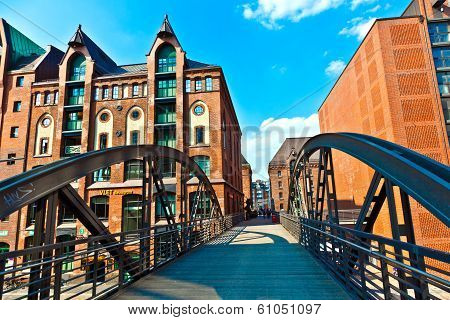 HAMBURG, GERMANY - MAY 9, 2014: famous old Speicherstadt in Hamburg build with red bricks. The Speicherstadt became world cultural heritage in 2015.