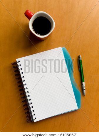 Kopje koffie en Notebook
