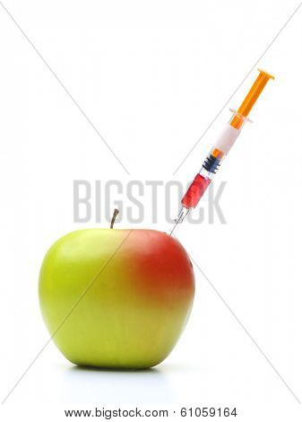 Green apple being modified by injecting red modifier - GMO concept