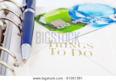 Credit Card And The Ball Pen On The Page Of An Organizer With The Words