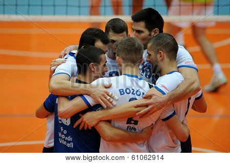 KAPOSVAR, HUNGARY - FEBRUARY 25: Kaposvar players celebrate at a Hungarian National Championship volleyball game Kaposvar (white) vs. Sumeg (green), February 25, 2014 in Kaposvar, Hungary.