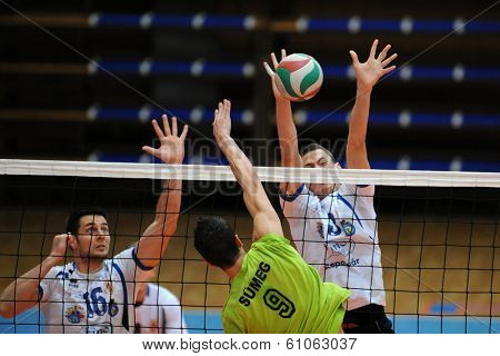 KAPOSVAR, HUNGARY - FEBRUARY 25: Ferenc Nemeth (white 16) in action at a Hungarian National Championship volleyball game Kaposvar (white) vs. Sumeg (green), February 25, 2014 in Kaposvar, Hungary.