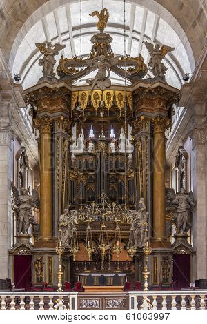Lisbon, Portugal - September 15, 2013: Baroque altar under baldachin. Church of the Sao Vicente de Fora Monastery. Very important monument in Lisbon, Portugal. 17th century Mannerism