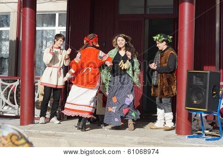 Mstyora,Russia-February 28,2014:Young people in suit of the fairy-tale heroes dance on holiday of th