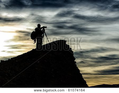 Photographer Silhouetted against Sky