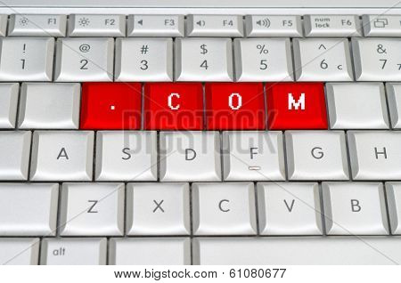 Internet Top Level Domain .com Spelled On Metallic Keyboard