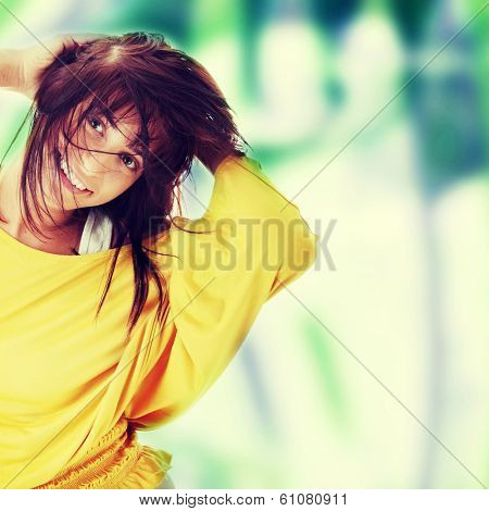 Sexy, beautiful, young woman dancing (hair flying)