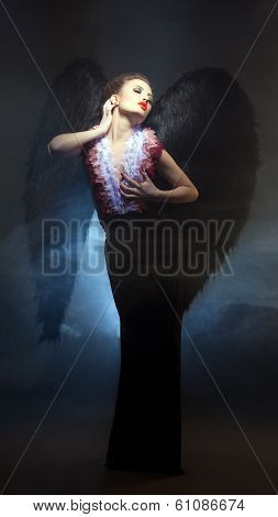 Voluptuous woman posing similitude of fallen angel