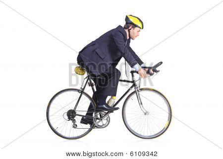 Businessman In A Suit Riding A Bicycle