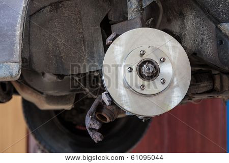 Front Disk Brake On Car In Process Of Damaged Tyre Replacement.