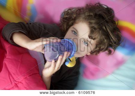 Adorable Little Girl Drinking Bottle