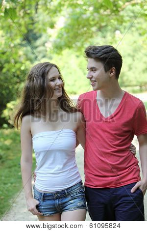 Attractive Teenage Couple Out Walking