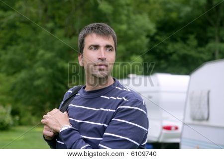 Caucasian Man Relaxed On Camping Meadow