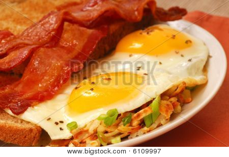 Eggs, Bacon, Toast And Hash Browns
