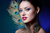 image of female peacock  - young gorgeous brunette with peacock style makeup - JPG