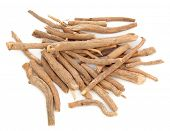 foto of ginseng  - Ginseng herb in a pile over a white background - JPG