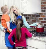 stock photo of overwhelming  - Overwhelmed and frustrated Mom in the kitchen - JPG