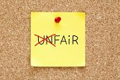 pic of disadvantage  - Turning the word Unfair into Fair with red marker on yellow sticky note pinned with red push pin - JPG