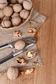 pic of nutcrackers  - Nutcracker with walnuts on wooden background - JPG