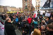 KRAKOW, POLAND - FEB 22, 2014: Unidentified participants during demonstration on Main Square, in sup