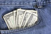 American dollar bills in jeans pocket
