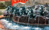 pic of dragon head  - Water flows from a series of dragon heads into a pool in Japan - JPG