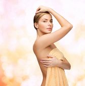 health and beauty concept - beautiful woman in towel