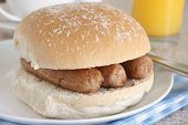 stock photo of bap  - Sausage sandwich or sausage bap a favourite British snack - JPG