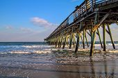 stock photo of atlantic ocean beach  - Myrtle Beach State Park pier jutting into the Atlantic Ocean  Myrtle Beach - JPG