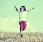 Little boy running feeling happiness and freedom on instagram filter