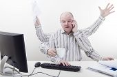 stock photo of stare  - Busy and multitasking office worker with arms all over in the office - JPG
