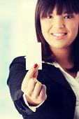Portrait of a beautiful businesswoman holding a white card.