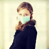 picture of swine flu  - A model wearing a mask to prevent  - JPG