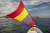 picture of horsetooth reservoir  - canoe bow with a downwind sail  on Horsetooth Reservoir in Colorado near Fort Collins - JPG
