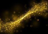 foto of gold-dust  - Gold glittering stars dust trail background - JPG