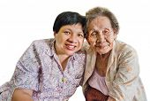 image of niece  - Family Portrait of an Asian elder mother and daughter hugging in isolated background - JPG