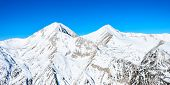 foto of gory  - Winter landscape of mountains covered snegom - JPG