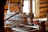 image of loom  - Wooden loom stands in private rustic hut