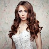 stock photo of charming  - Portrait of beautiful sensual woman with elegant hairstyle - JPG