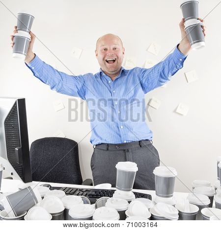 Happy and coffee addicted businessman at office