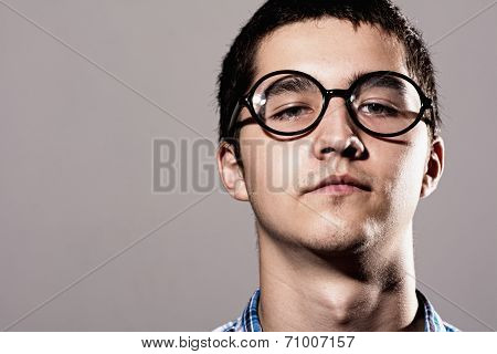 Close-up Portrait Man In Glasses With A Thoughtful Expression On His Face