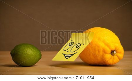 Lemon with sticky post-it note reacting to lime