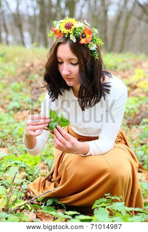 Beautiful Girl With Flower Wreath On Her Head In The Autumn Nature
